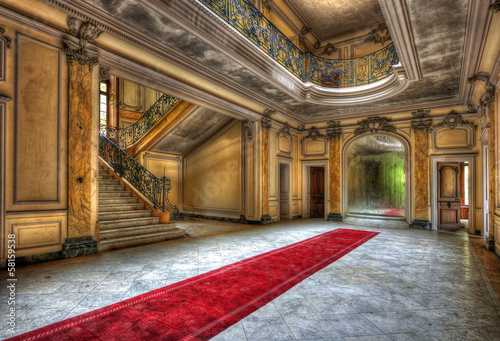 Red carpet in the hallway of an abandoned manor Fototapeta