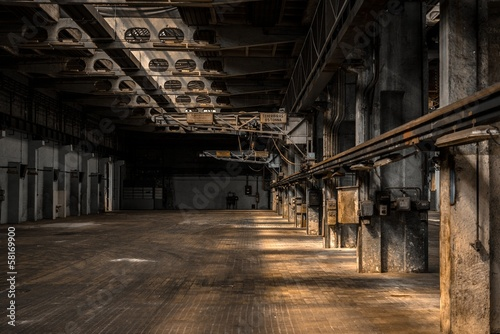 Poster Old abandoned buildings Large industrial hall of a repair station