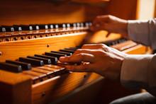 Man Playing A Church Organ