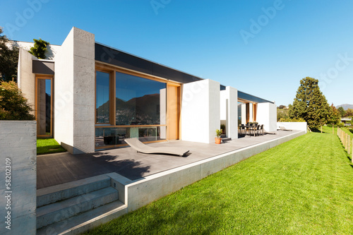 Modern house in cement, view from the garden