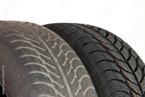 old and new winter car tires © algre