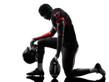 American Football Player Kneel...