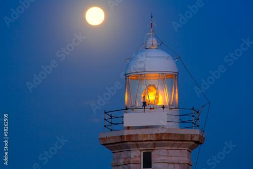 In de dag Volle maan Ciutadella Menorca Punta Nati lighthouse moon shine