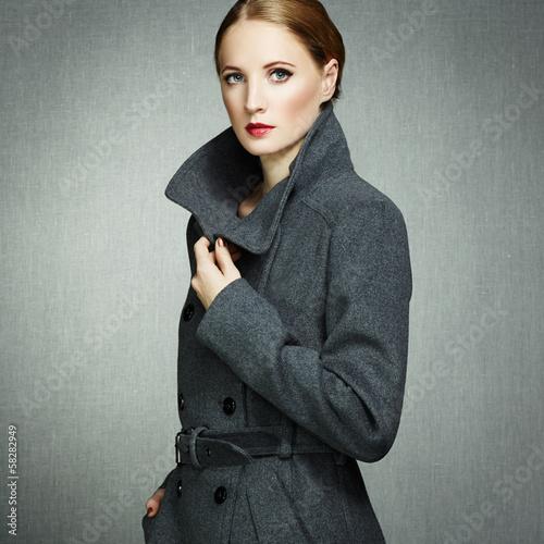 Fotografie, Obraz  Portrait of young woman in autumn coat