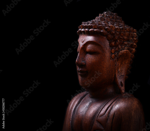 Tuinposter Boeddha Buddha portrait against dark background
