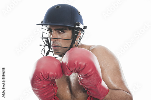 Portrait of a male boxer practicing boxing - 58306518