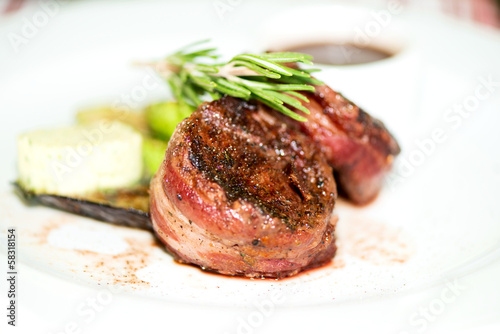 grilled steak wrapped in bacon with grilled vegetables close up Wallpaper Mural