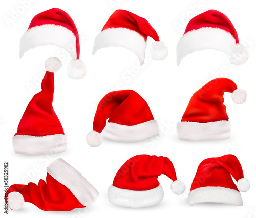 Fototapeta Collection of red santa hats. Vector. obraz