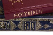 Close-up Of The Koran And The Bible