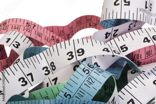 Fotografie, Obraz  Close-up of tangled tape measures
