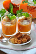 two glasses with pumpkin soup and bread