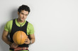Portrait of a man holding a basketball
