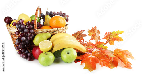 Keuken foto achterwand Vruchten Composition of different fruits with basket and yellow leaves