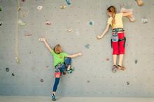 Two Little Girls Climbing A Ro...