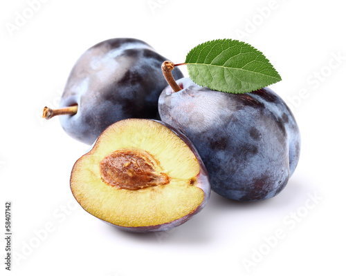 Ripe plums with leaf