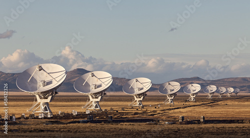 Valokuva  Very Large Array satellite dishes at Sunset in New Mexico, USA