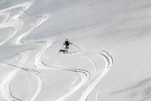 Ski Trails Cutting Through Thin Crust Of Ice Over The Snow