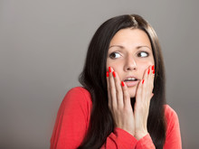 Portrait Of A Shocked Girl Looking Away, Gray Background