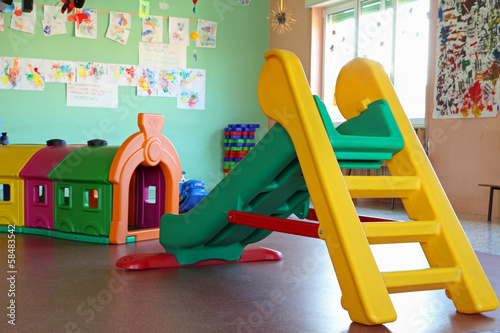 Valokuva  slide and plastic tunnel in the playroom of a preschool