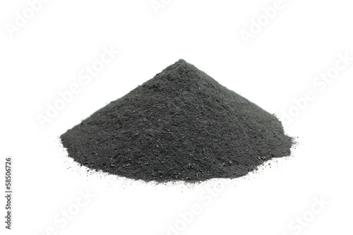 a handful of powdered charcoal on white background Fototapete