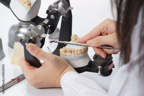 Dental technician working with articulator in dental laboratory Canvas-taulu