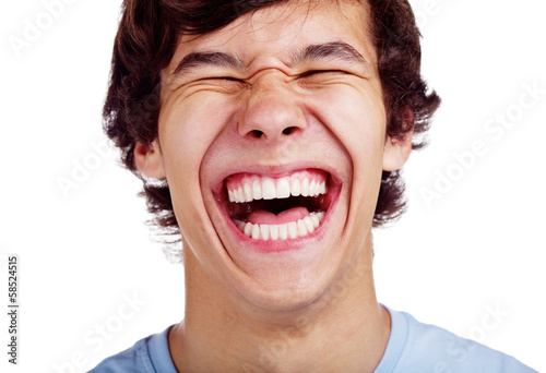 Foto Happy teenage laugh closeup over white