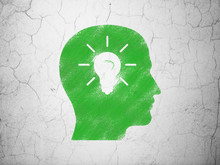 Marketing Concept: Head With Light Bulb On Wall Background