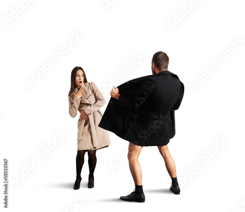 Fototapeta frightened woman looking at exhibitionist