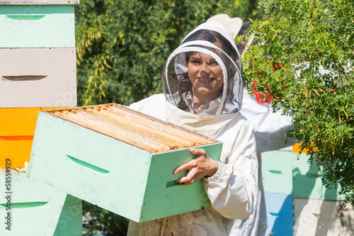 Portrait Of Beekeeper Working At Apiary Canvas Print
