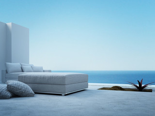 Fototapeta na wymiar White couch standing on a patio with seascape view