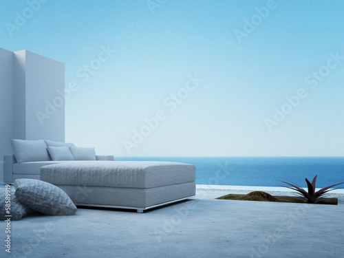 Fototapeta White couch standing on a patio with seascape view