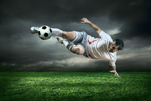 Football Player With Ball In A...