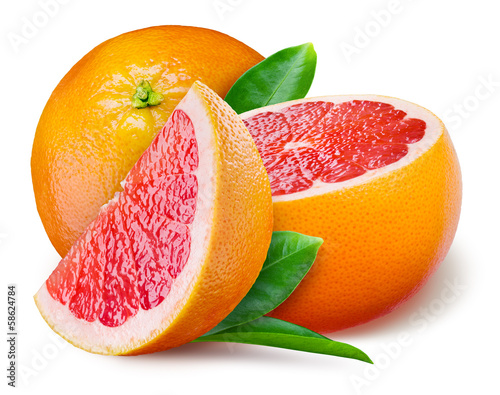 Fotografia Grapefruit with a half and leaves on white background