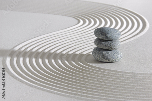 Recess Fitting Stones in Sand Japanese ZEN garden with stacked stones