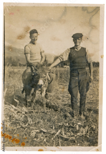 CIRCA 1940: Two young farmers posing on a cornfield Canvas Print