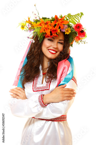 Foto op Canvas Schepselen Beautiful ukrainian young woman in garland of summer flowers and