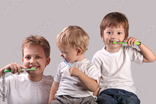 Photo Stands Grocery three brothers brushing teeth together