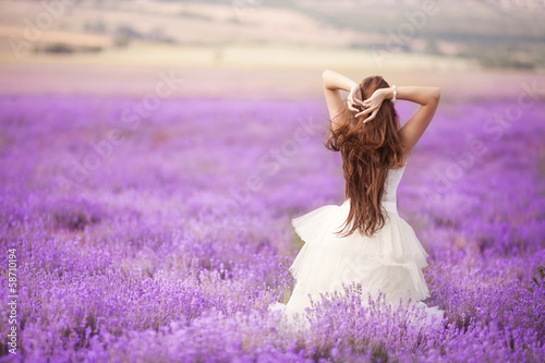 Obraz Bride in wedding day in lavender field - fototapety do salonu