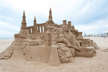 Grand Sandcastle On The Beach During A Summer Day.
