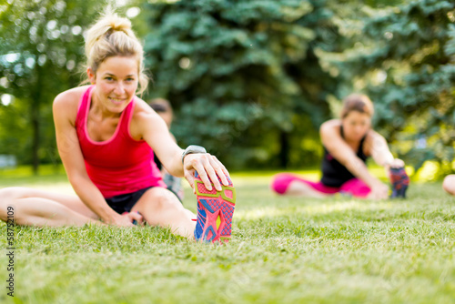 Papiers peints Jogging young woman stetching before a jog