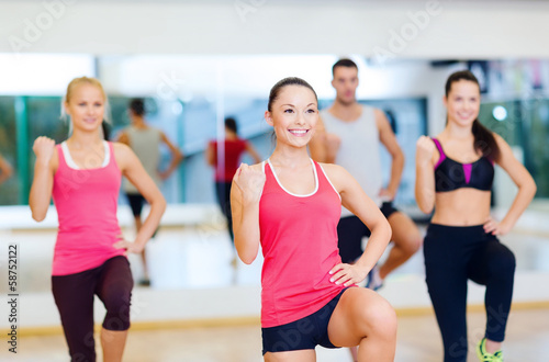 Fotografie, Obraz  group of smiling people exercising in the gym