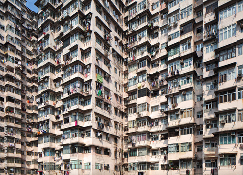 Overcrowded residential building Poster