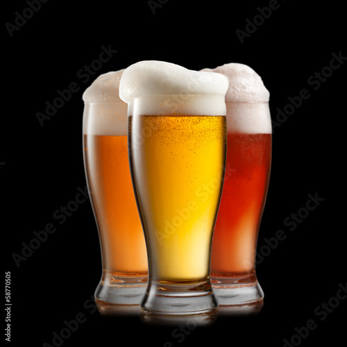 Foto op Canvas Alcohol Different beer in glasses isolated on black background
