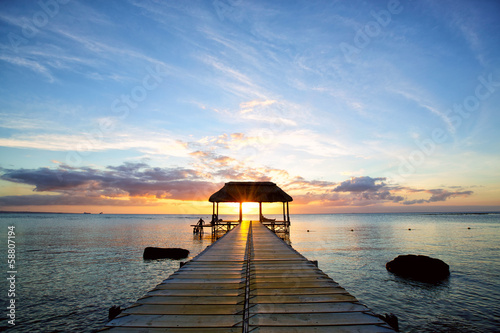 Jetty silhouette against beautiful sunset in Mauritius Island Poster