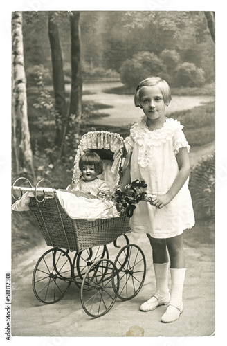 old photo of little girl with doll toy