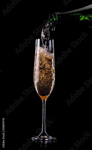 Golden champagne in glass Canvas Print