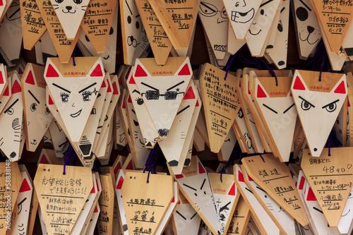 Foto auf Leinwand Kyoto Fox shaped praying cards at Fushimi Inari shrine in Kyoto