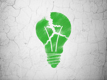 Business Concept: Light Bulb On Wall Background