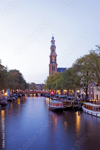 Photo  Amsterdam by night with the Westerkerk in the Netherlands