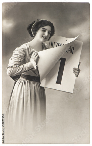 young woman with calendar. antique New Years postcard